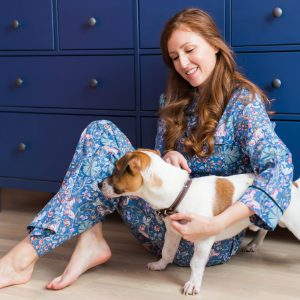 happy-young-woman-sitting-with-her-dog-at-home-pet-ZAMRHMZ